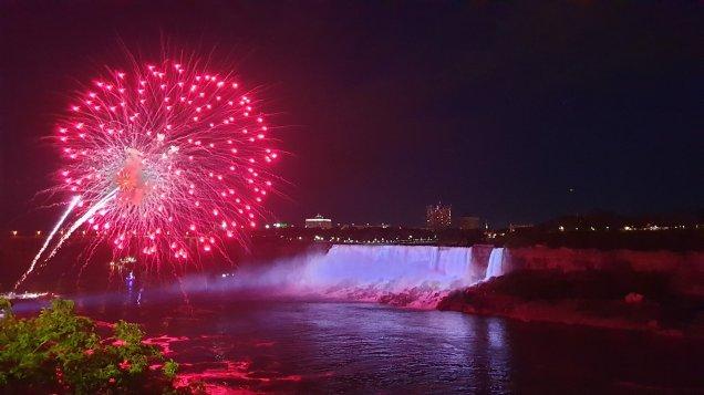 Fireworks over Niagara Falls at night