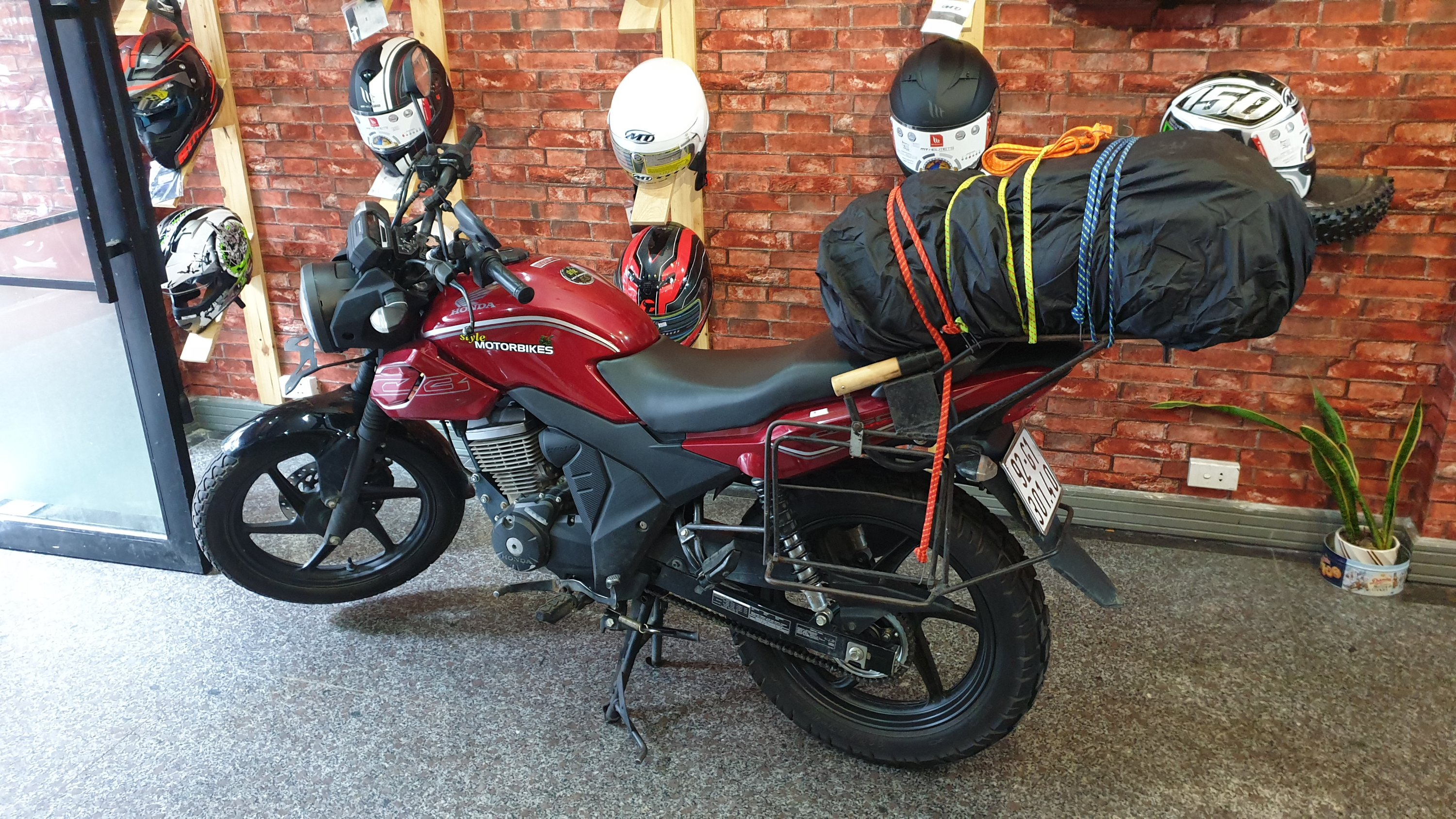 Bike loaded with luggage in the shop before leaving