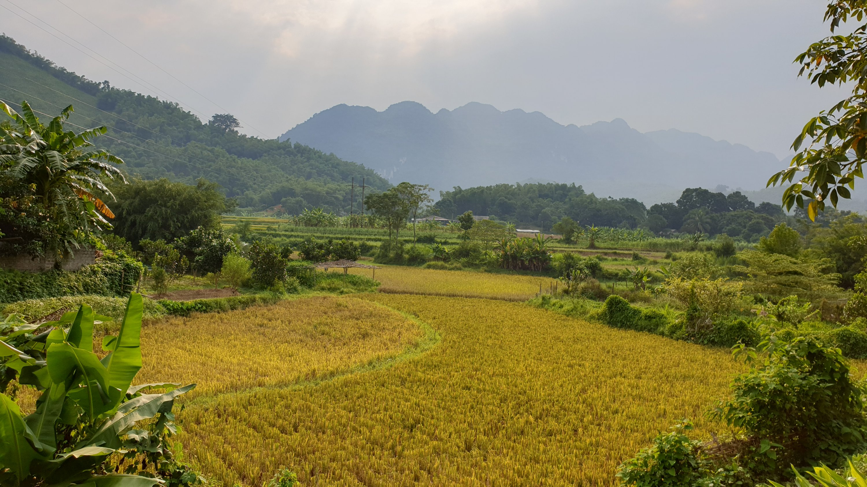Sun rising in Pu Luong over rice fields and mountains