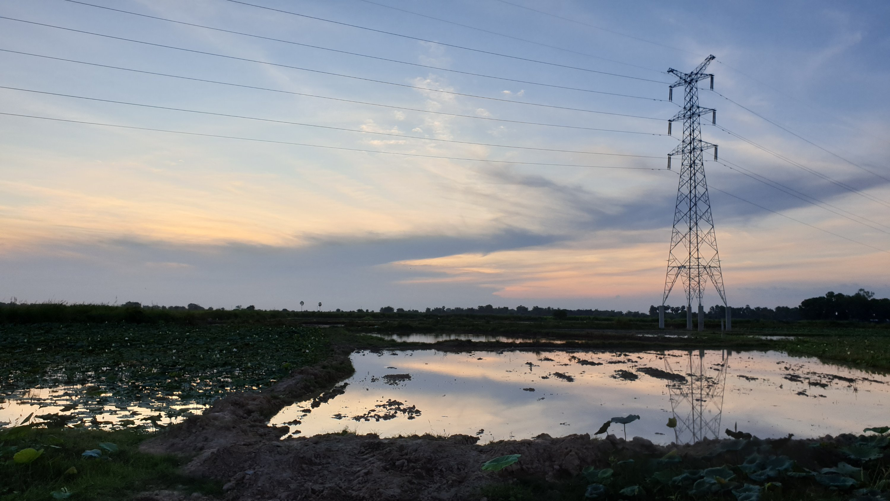 Sunset with electricity pylon in the foreground, Cambodia