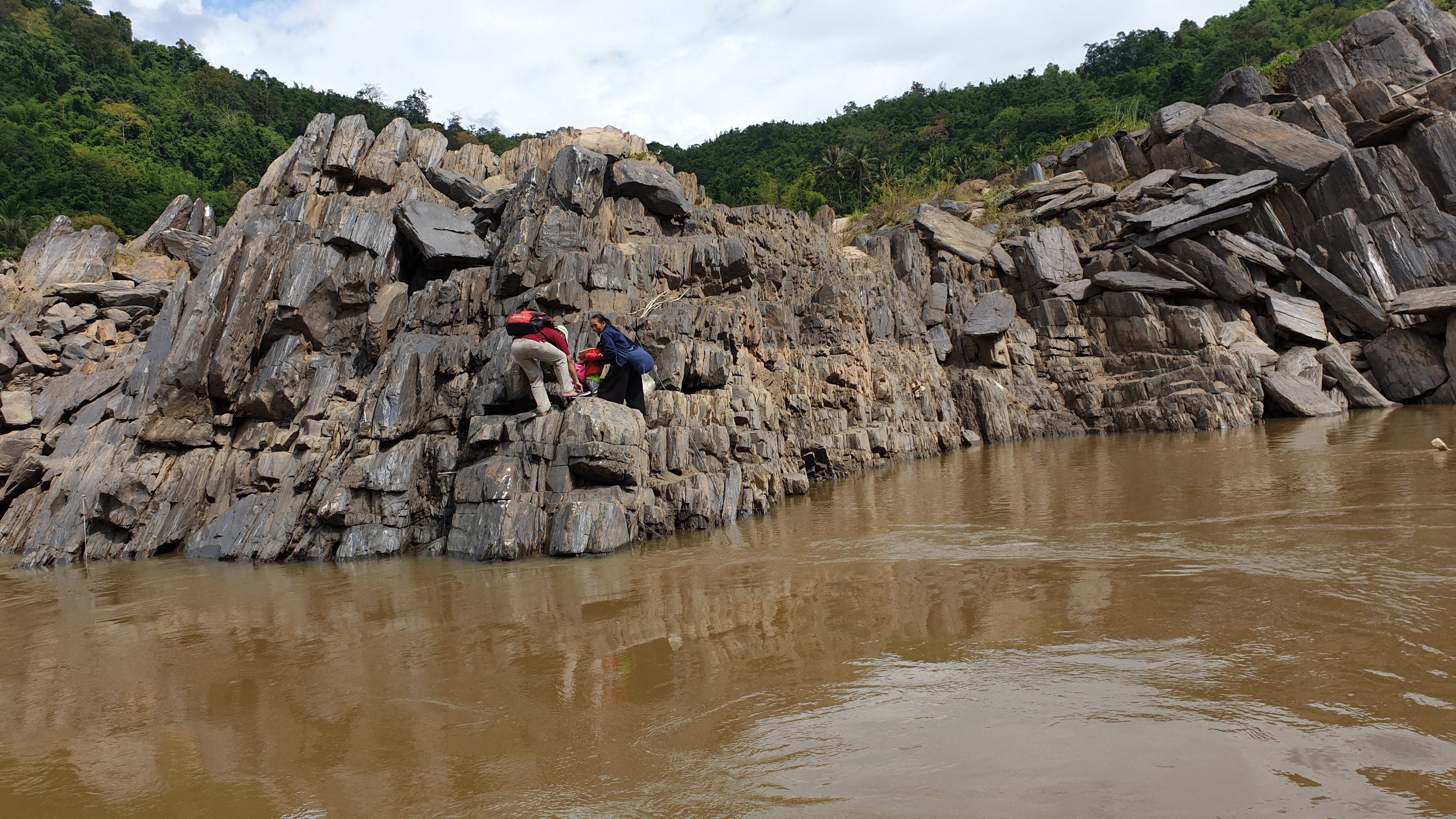 Dropping locals off on a rock from a slow boat in Laos on the Mekong river