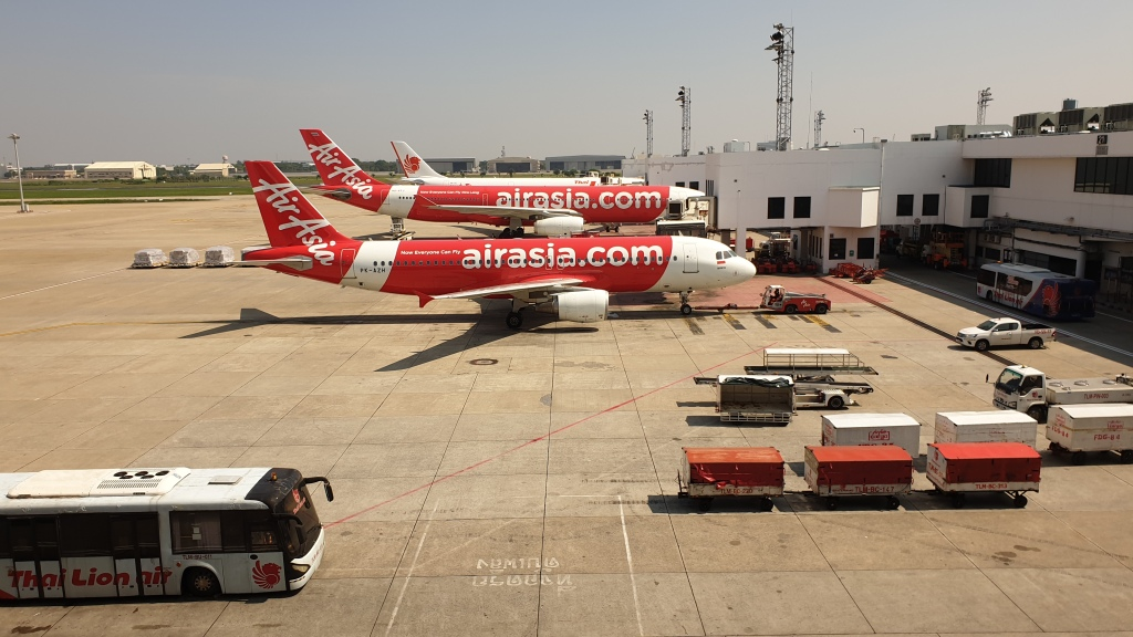 AirAsia planes lined up at Bangkok International Airport